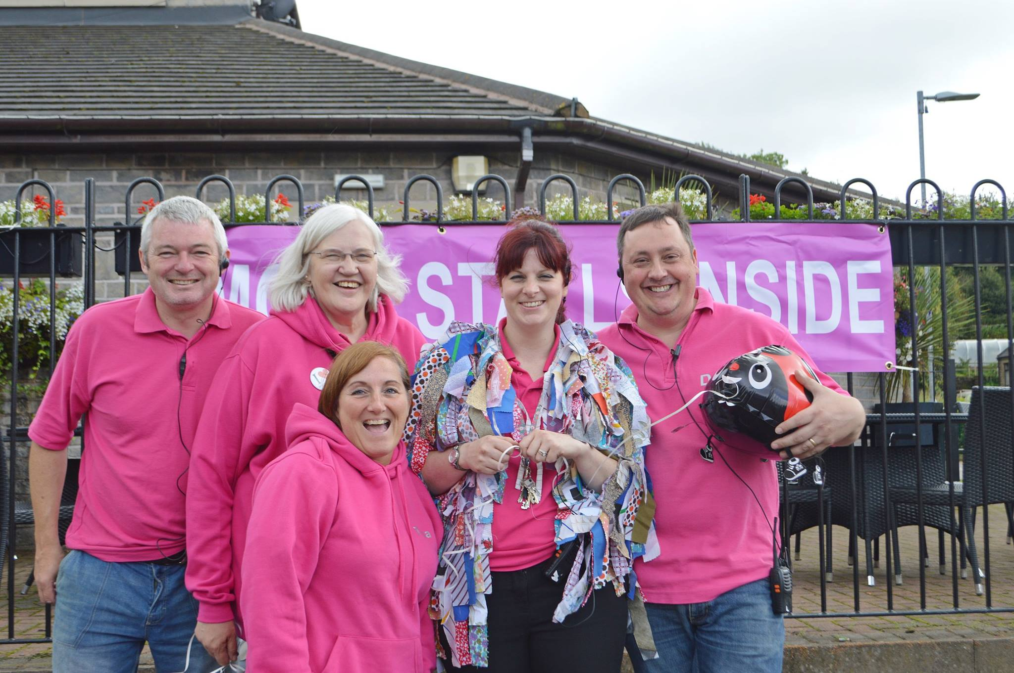 A photo of some of the Tourism and Leisure Committee enjoying volunteering at the Rushcart in their hot pink uniforms!