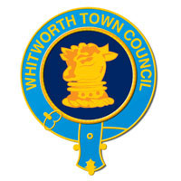 The logo of Whitworth Town Council is a golden bulls head in a navy circle wrapped with a sky blue belt.