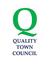 The Quality Town Council logo
